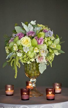Beautiful floral arrangement in glass urn.