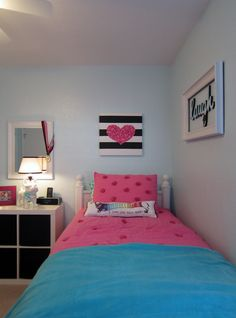 Lauren likes the Laugh picture and how the nightstand has storage in it.