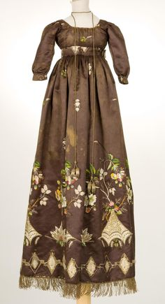 Dress--1800s.  The detail on this dress is so amazing!  Look at the fringe at the hem.  The embroidery is gorgeous.  Then, there is the cord used as a necklace or neck detail.