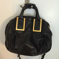 Chloe satchel Beautiful black Chloe satchel well worn in but still has a lot of life left, there's a part of it were the wire is exposed but I colored it in with a sharpie and it's not noticeable at all this is a great deal to get a designer bag for less it's a gorgeous bag in person Chloe Bags Satchels