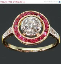 Art Deco ruby and diamond halo ring from adinantiquejewellery on Etsy.