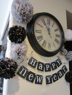 What a great idea for New Year's! - just hang a banner sign near a clock in your house and add the tissue paper flowers.