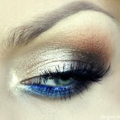 This glamorous look uses gold eye shadow blended with black and brown to give the perfect night out look. Blue eyeliner adds the perfect pop of color to make your eyes stand out.