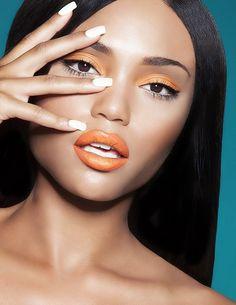 Orange eyeshadow and lipstick