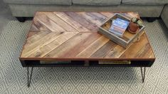 This beautiful Chevron Pallet Coffee Table with rebar hairpin legs was made out of reclaimed pallet wood and has an orange oil wax finish. The