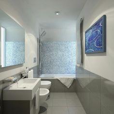 salle de bain en blanc et gris avec mur d'accent en mosaïque bleue