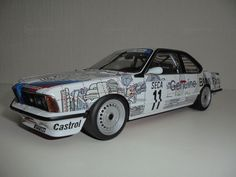 Diecast BMW 635 CSi, AUTOart BMW dealer edition 1:18 modelcar in racing / multicolored color by 'Gerre'