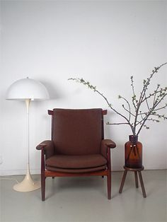 """Bwana chair FD 152 (1962) from Danish designer Finn Juhl. Juhl - father of the Danish design - added organic shapes to the modernistic style of is time. One of the more famous quotes from Finn Juhl can be applied to all of his work: """"One cannot create happiness with beautiful objects, but one can spoil quite a lot of happiness with bad ones""""."""