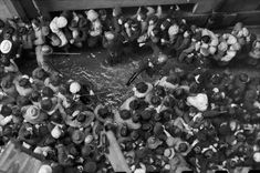 CHINA. December 1948-January 1949. Shanghai. As the value of the paper money sank, the Kuomintang decided to distribute 40 grams of gold per person. With the gold rush, in December, thousands came out and waited in line for hours. The policemen,...