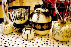 Black and gold pumpkins.. lots of ribbon and rhinestones! I am making these on craft day!!
