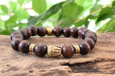 Unisex Bracelet with Dark Brown Wood beads and Bronze tone metal Buddha Head bead. Brown Wood, Dark Brown, Bracelets For Men, Beaded Bracelets, Buddha Beads, Wood Bracelet, Bronze, Unisex, Metal