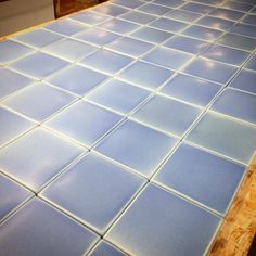 Chill baby!  Pale blue matte glaze on 6x6 field tiles feels nice and cool on a hot one like today.  #handmade #artisan #ceramic #tile #handmadetile #tileaddiction #madeinmichigan #annarbor #paleblue #blue #customdesign #matte #architecture #ceramictiles #interiordesign #distinctive #texture #luxe #nofilter #smooth by motawi_tileworks