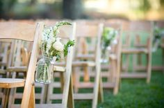 Maybe the flowers on the tables could have hangers so that they could go on the chairs for the reception?