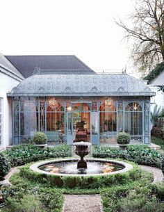 Classic French style meets grand country living. A Victorian conservatory was added on to the house to bring in light and integrate the exterior and interior. Magoesbaskloof, Limpopo. By The Crystal Conservator