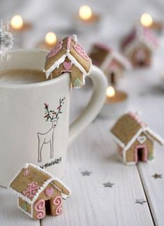 """Tiny gingerbread houses that fit on the rim of your hot cocoa mug! Such a cute Christmas decor idea and fun DIY recipe to make with kids! See more """"62 Impossibly Adorable Ways To Decorate This Christmas"""" on Buzzfeed."""