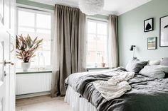 Bedroom with light green walls and grey bedding Light Green Bedrooms, Bedroom Green, Dream Bedroom, Home Bedroom, Bedroom Decor, Linen Bedroom, Interior Design Living Room, Living Room Decor, Bedroom Styles