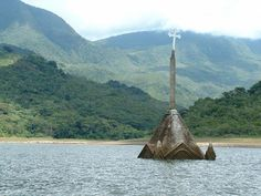 The Church in Potosi Venezuela was submerged, along with the entire town in 1985. During a recent drought, the church, grave markers, the ruins of houses and the outline of the former town square have reemerged. The church was entirely exposed, although only its facade remains.
