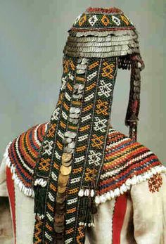Chuvash married woman's khushpu  headdress with a beaded plait cover.  From Saratov Province in the Lower Volga Region, dated late 19th century. || Collection of the Russian Ethnography Museum, Saint Petersburg.