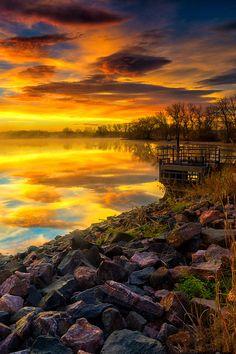 Fall Sunrise reflections at Lake Ladora in Denver, Colorado, USA