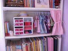 American Girl strorage shelf used a 9 x 9 revolving scrapbooking cube    http://www.gymbofriends.com/off-topic/1333092-toy-organizing-i-made-little-doll-space.html