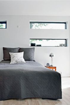 horizontal window above bed