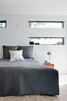 horizontal window above bed