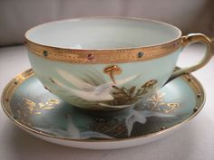 ANTIQUE NIPPON MORIAGE JEWELED FLYING SWANS, GEESE, CRANES CUP AND SAUCER