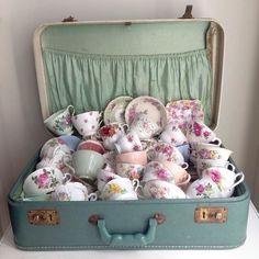 Vintage Tea Cups In A Suitcase.