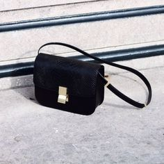 Sleek and simple black shoulder bag with gold buckle. Perfect size and shape for daytime or night. Givenchy, Gucci, My Bags, Purses And Bags, Celine Box, Fashion Gone Rouge, Chanel, Black Shoulder Bag, Shoulder Bags