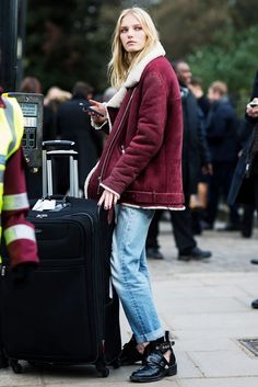A burgundy suede shearling-lined moto jacket pairs well with cuffed jeans and cool black boots