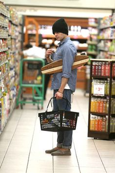 And he can hold his board under his arms like this while he smolderingly searches for groceries: | Zac Efron Went Skateboarding Through A Grocery Store