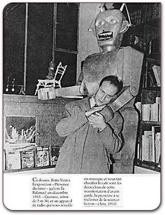 "Boris Vian with ""Gustave"" (before he was renamed Anatole) at the Science and Fiction Exposition in France, December 1953."
