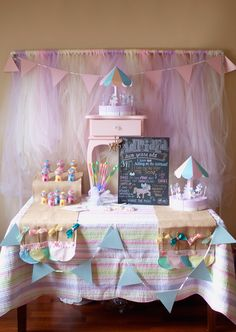 Nice decor favor table DIY backdrop tulle n pvp piping. Cute gumball favors