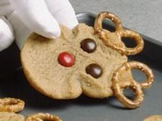 I would move the RED M&M to the bottom of the cookie.  That would make it look more like Rudolph!
