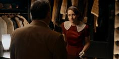 Café Society (2016) - Kristen Stewart as Vonnie wearing a dark red satin dress with short balloon sleeves pleated organza collar double row of buttons on the bodice and thin belt. The accessories include mary-jane pumps her trademark satin ribbon as headband and white wrist gloves.  The costumes were designed bySuzy Benzinger.