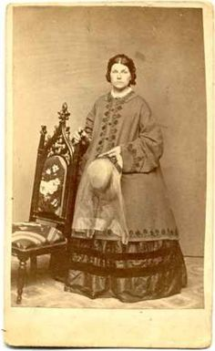 Woman with a paletot. A paletot was a short greatcoat that was either single or double breasted, with a small flat collar and lapels