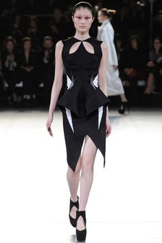 The cutouts of the front are super cute and I also love the details of the 3-d darts. Avant garde designer Muglar. #FW2012 #PFW