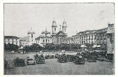 """Praça de Dom Pedro II com carroças voltadas para o Largo de São Francisco, o Convento do Carmo,  a igreja de Nossa Senhora do Monte do Carmo e a igreja da Ordem Terceira do Carmo, Rio de Janeiro, 1838.  A praça que hoje se chama Praça XV teve outros nomes, """"Piaçaba"""" (séc. XVI), """"Terreiro do Carmo"""", """"Terreiro da Polé"""", """"Praça Real da Sé Nova"""" (séc. XVIII), """"Largo do Paço"""" (séc. XIX). - Carriages at Dom Pedro II Square (actual 15th of november square), Rio de Janeiro,  1838."""