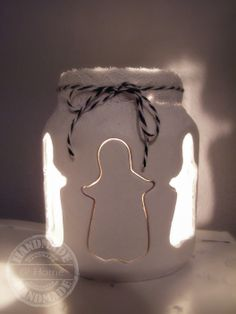jar of clay with candellight /angel christmas www.facebook.com/bizzyathome