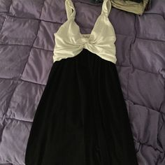 Black and White Bow Dress Bottom of dress is all black. Top is all white with material put together to look like a bow. Material is soft and stretchy. Has sewn in tie Dresses Midi
