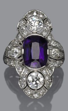 An Art Deco amethyst and diamond ring, circa 1925. Centring an oval-shaped amethyst; signed D.& Co.; estimated total diamond weight: 2.50 carats; mounted in platinum. The amethyst is not original to mounting.