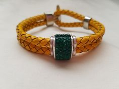 Yellow Braided Leather Bracelet with Green Gem - 09061601 by bisonbracelets…