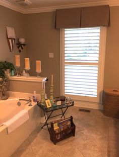 Single panel Plantation Shutters with a Board Mounted Fabric Valance by Budget Blinds of Savannah