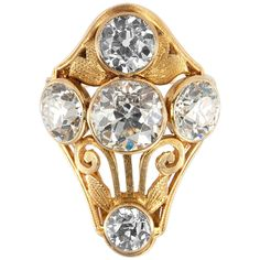 This stunning Arts & Crafts 18 karat yellow gold ring features a 1.82 carat Old European Cut diamond that is F-G in color and SI1 in clarity along with four other Old European Cut diamonds that are F-G in color and VS1-SI2 in clarity with the total diamond weight of 3.01 carats. #CraigEvanSmall