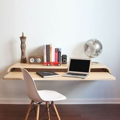 Transform any corner of your home into a workspace with this wall-mounting desk. Its open architecture keeps any space from feeling cluttered, while its sliding keyboard tray gives you plenty of room to spread out and get down to business. Finished in satin-smooth oak veneer, rift sawn for the most consistent and attractive grain, this desk can be mounted to almost any kind of wall (even brick!) at your preferred sitting or standing height.