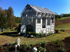Garden shed made from repurposed old doors and windows. Very cute!