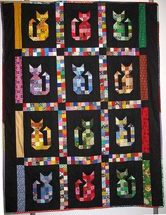 Scrappy cat quilt, photo only.                                                                                                                                                                                 More
