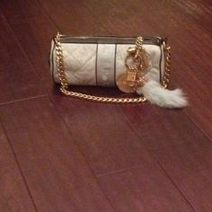Authentic Juicy Couture Handbag in great condition! this Juicy bag is perfect for any girl!! cute charms, including a real rabbit's foot!! Juicy Couture Bags