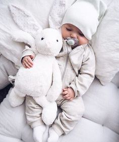 baby boy + rabbit stuffed animal