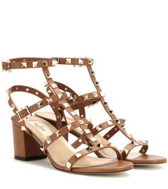 Valentino - Valentino Garavani Rockstud leather sandals - The Valentino 'Rockstud' family welcomes another new member. These sandals are crafted from a divine tan leather and finished, of course, with those signature studs that make them such an iconic addition to your wardrobe. We love the modest block heel - very chic and a more comfortable alternative to the stiletto. seen @ www.mytheresa.com